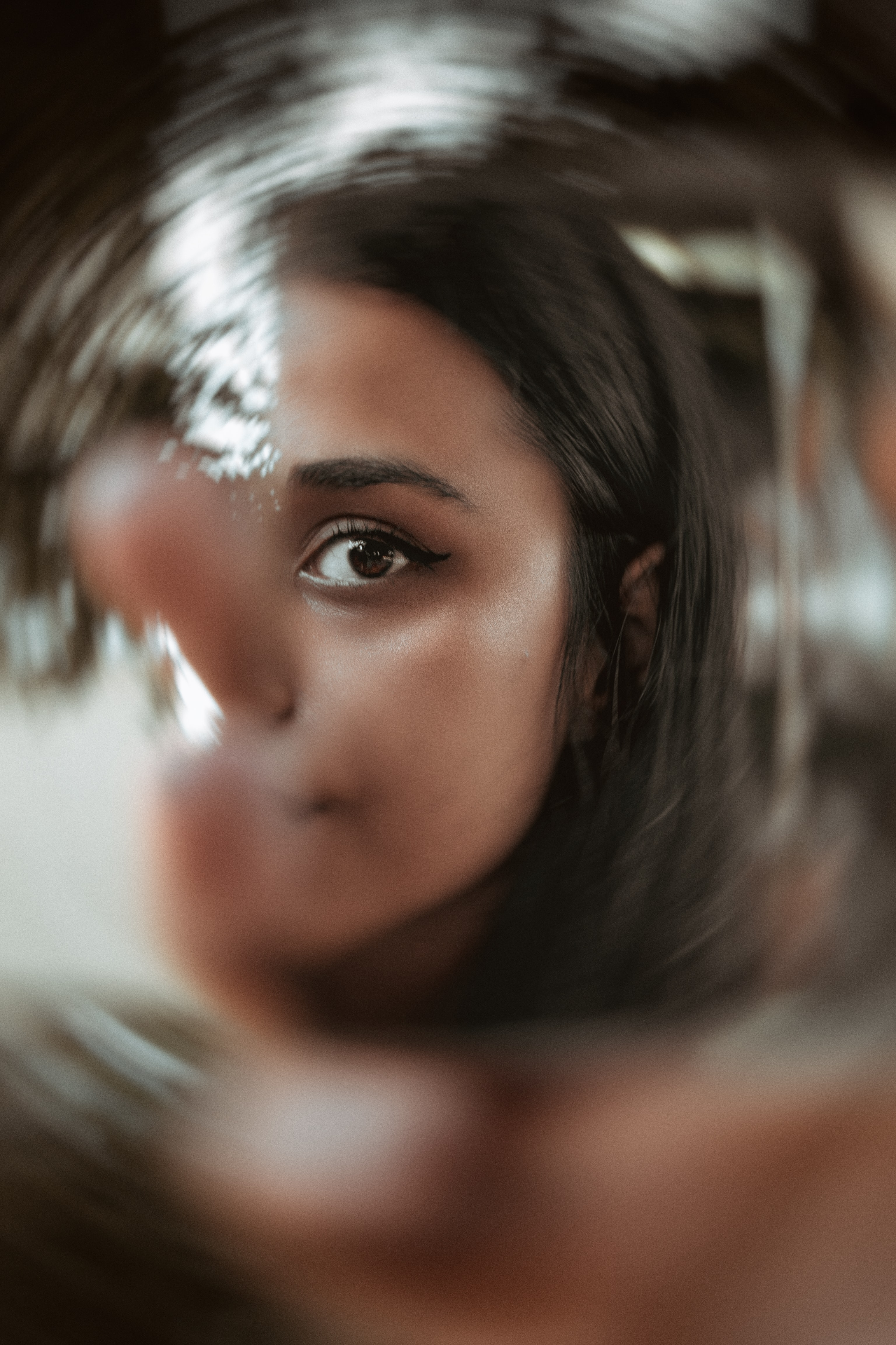 Girl looking through mirror