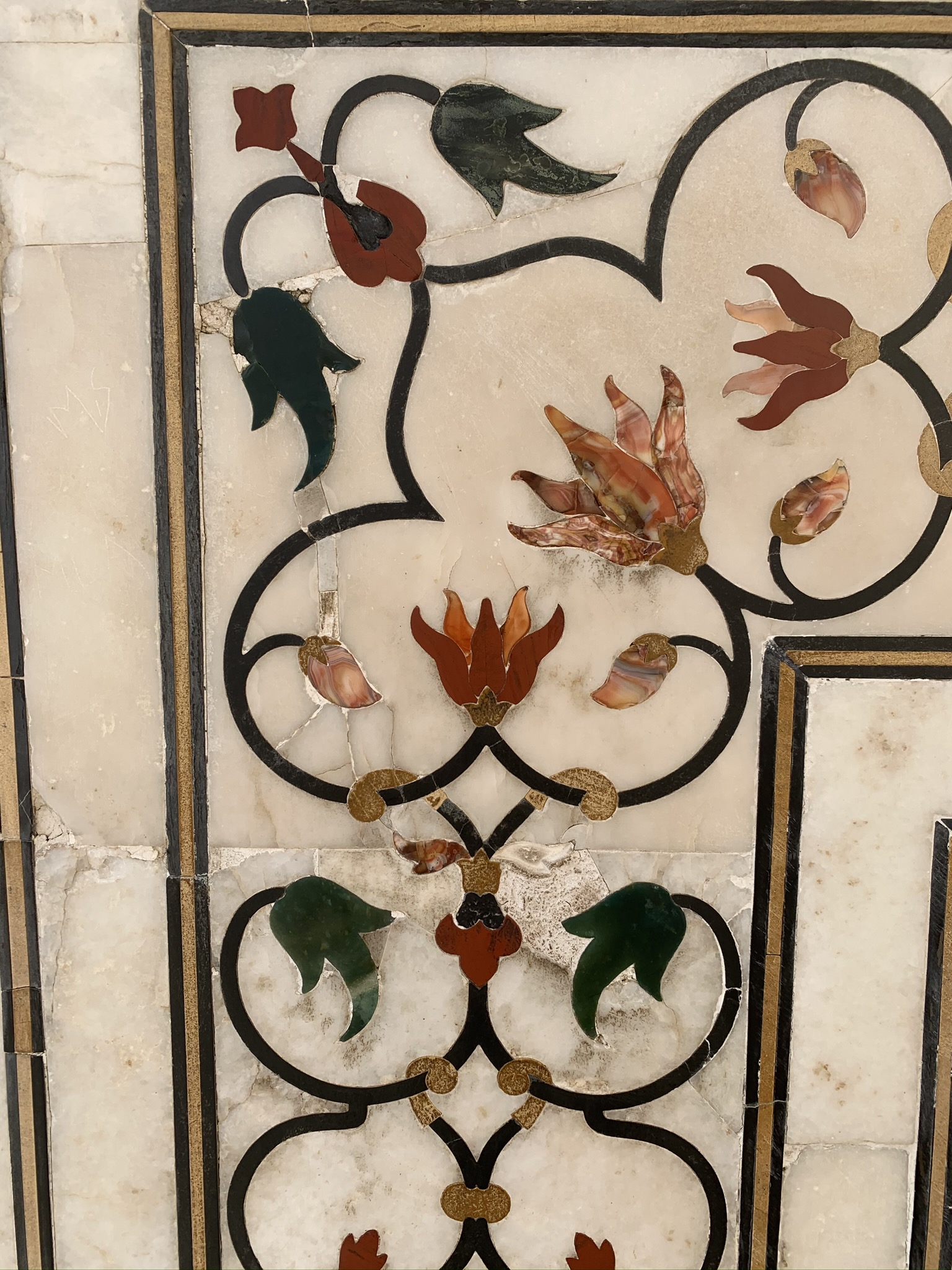 Detail of engraved jewels on Taj Mahal's walls