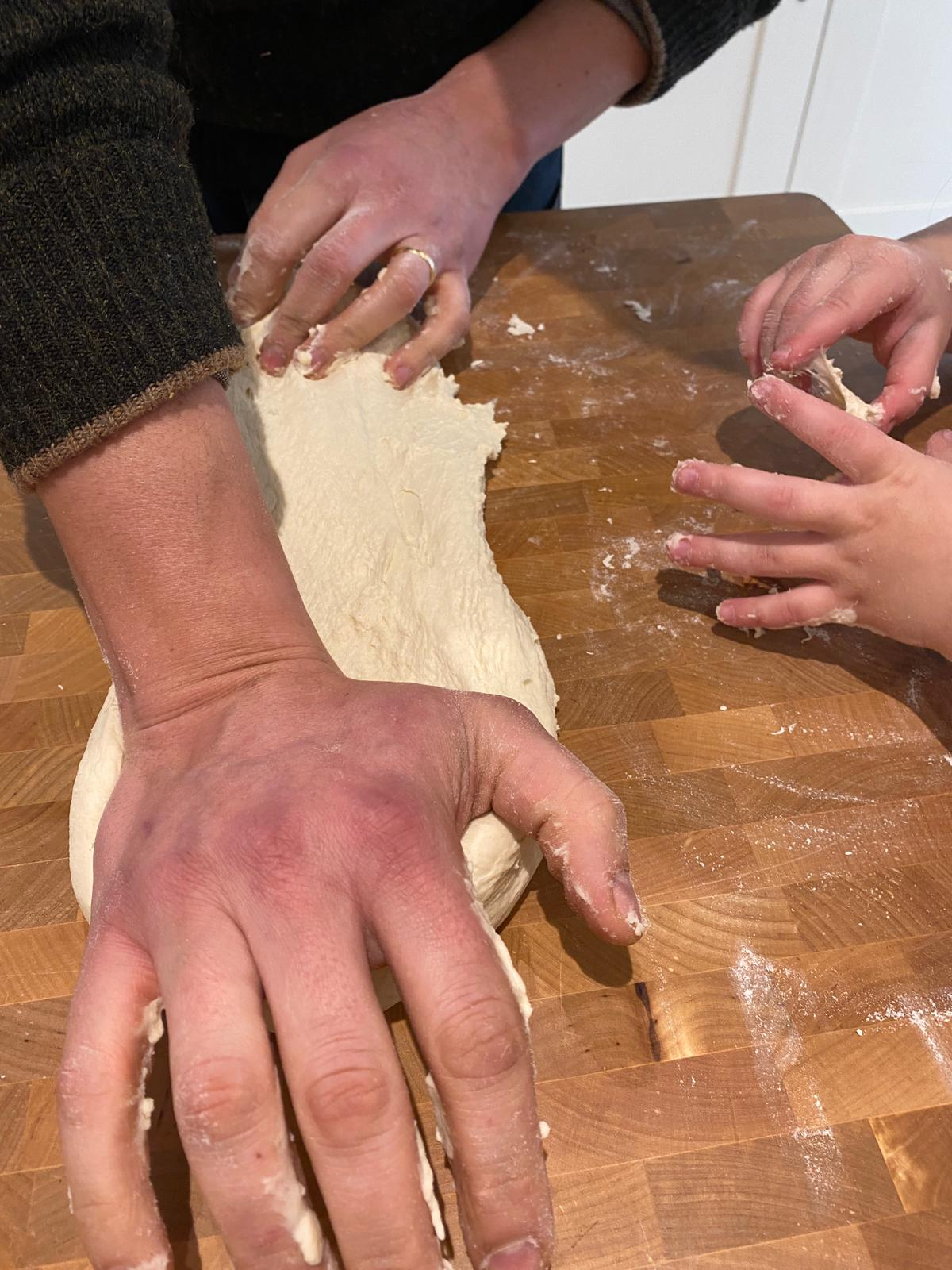 People shaping the focaccia