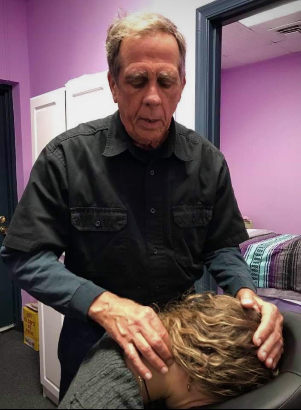 Dr. Steve giving a neck adjustment