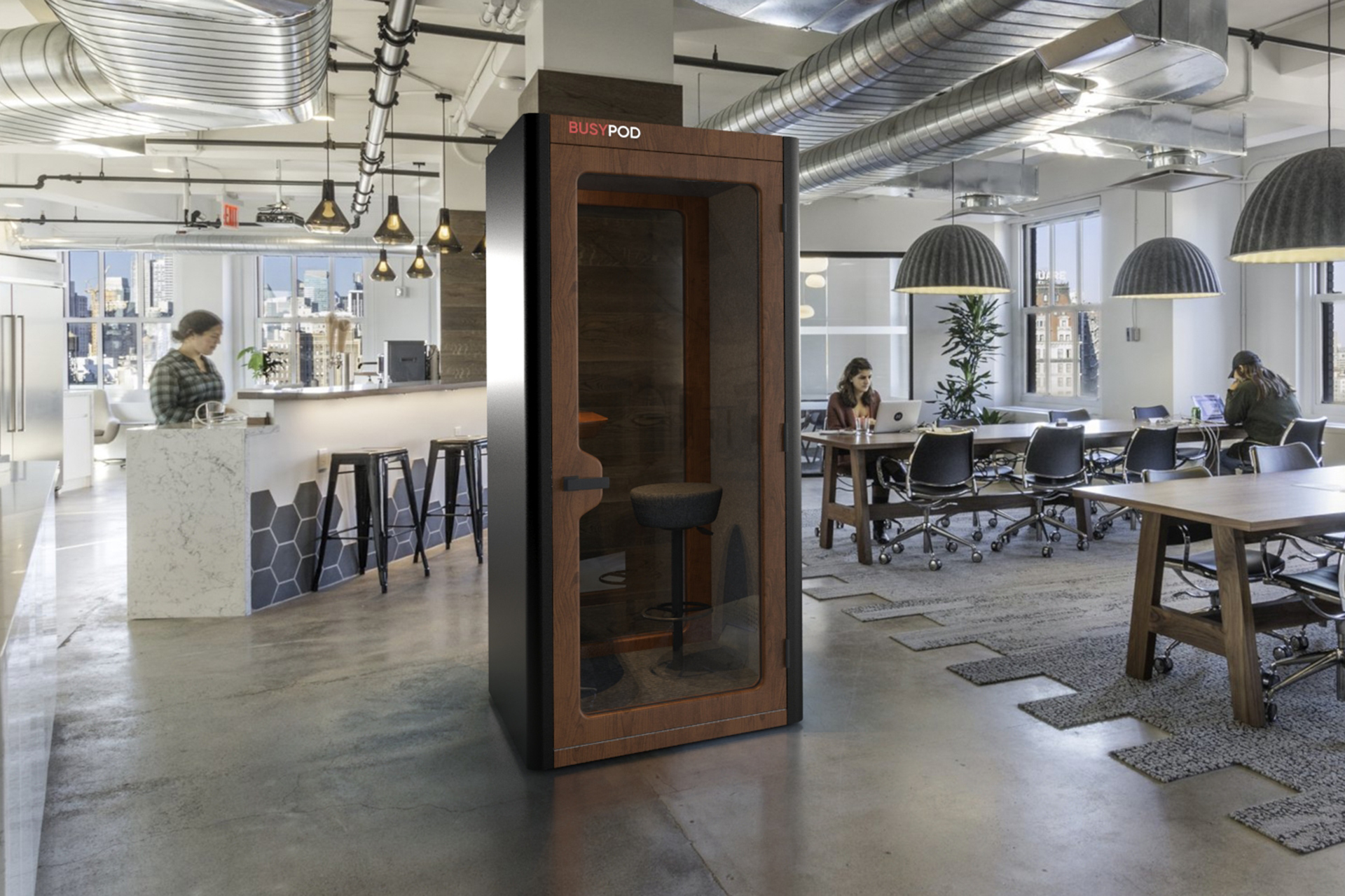 BUSYPOD Phone Booth, Black sides, Walnut frame in office pantry area