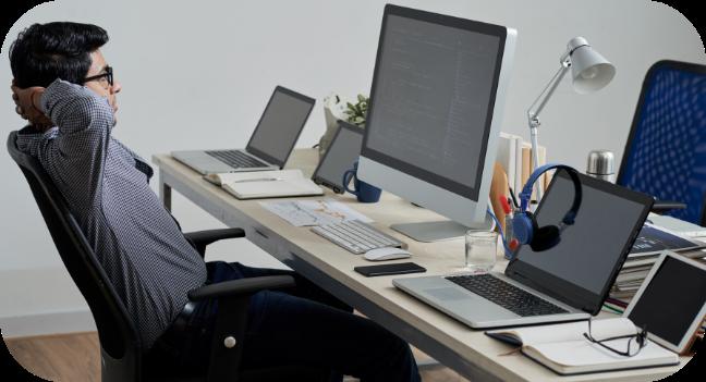 man sitting at the computer