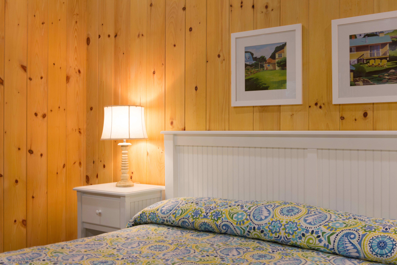 Inside of cottage showing bed