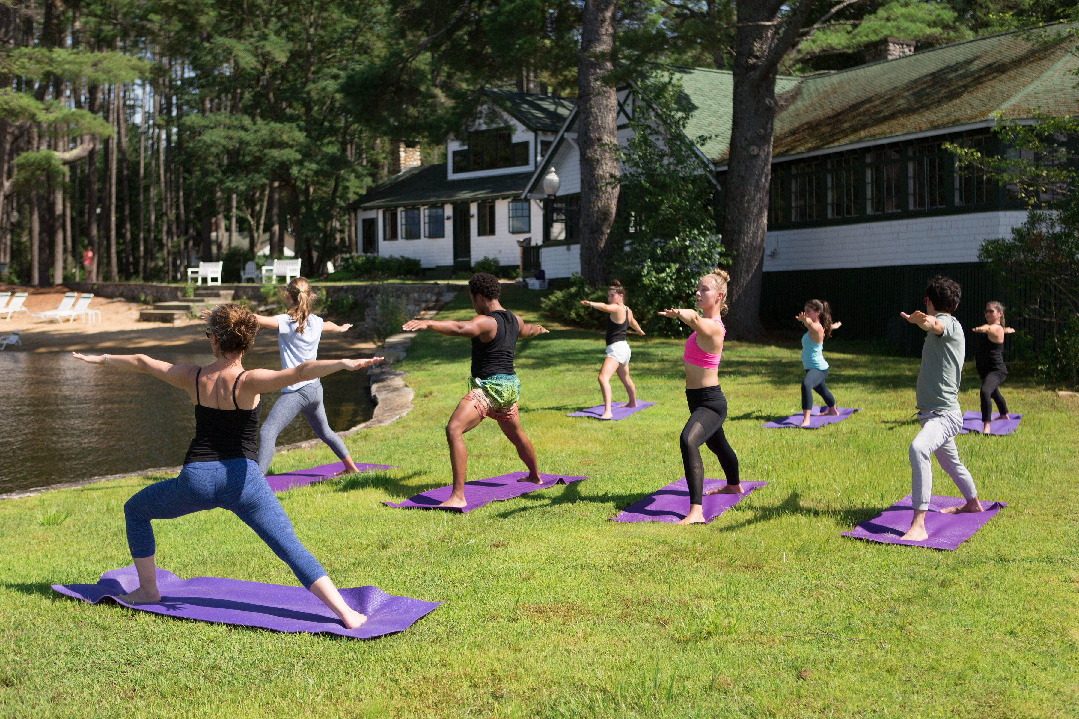 Group yoga on the grass