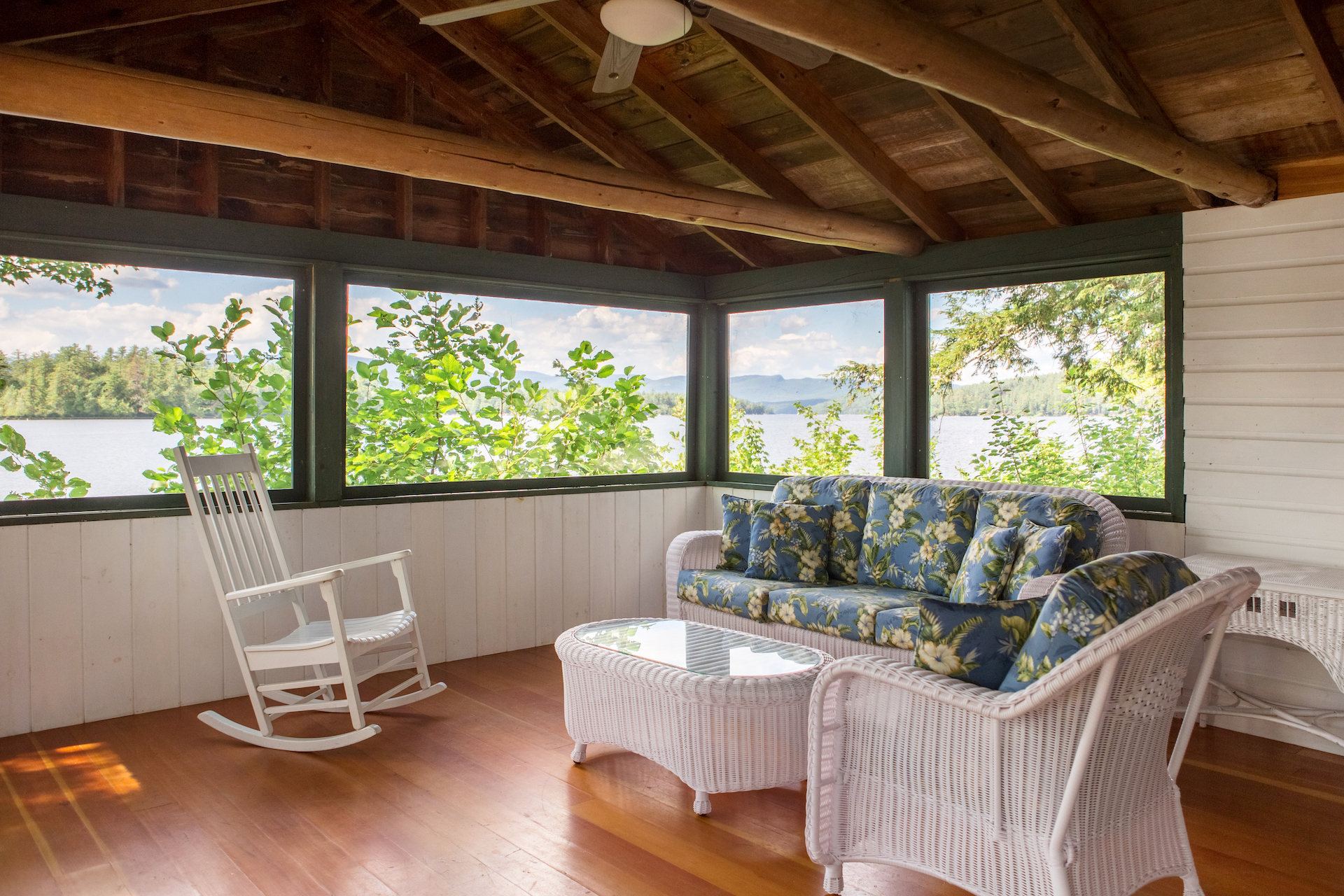 A view inside the sitting area of one of the cottages including a couch and two rocking chairs