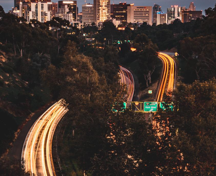 Cars racing around the city at night.