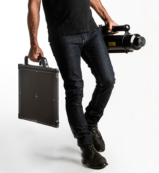 man holding digital xray equipment
