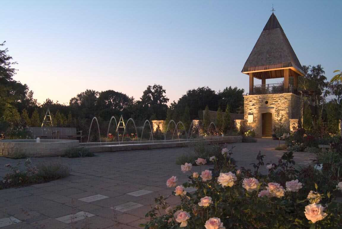 The rose garden is an extraordinary two-acre garden where a myriad of roses and colorful perennials are backdropped by fountains, intricate paving and a 30-foot tower featuring native stone and exquisite detailing.