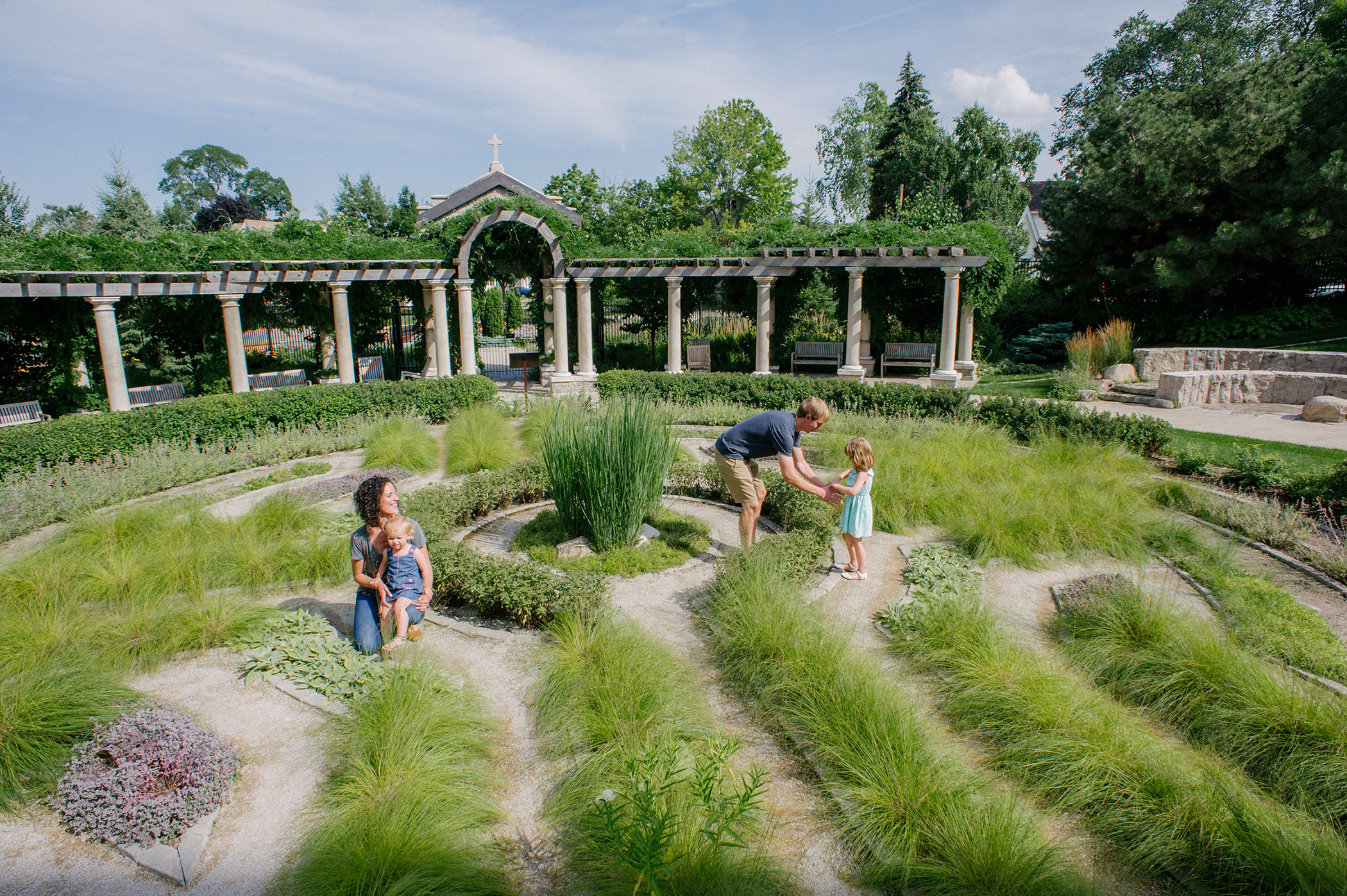 The gardens are rich in layered, seasonal plantings with water features of bubbling stones and stream channels weaving physically and metaphorically through the space.