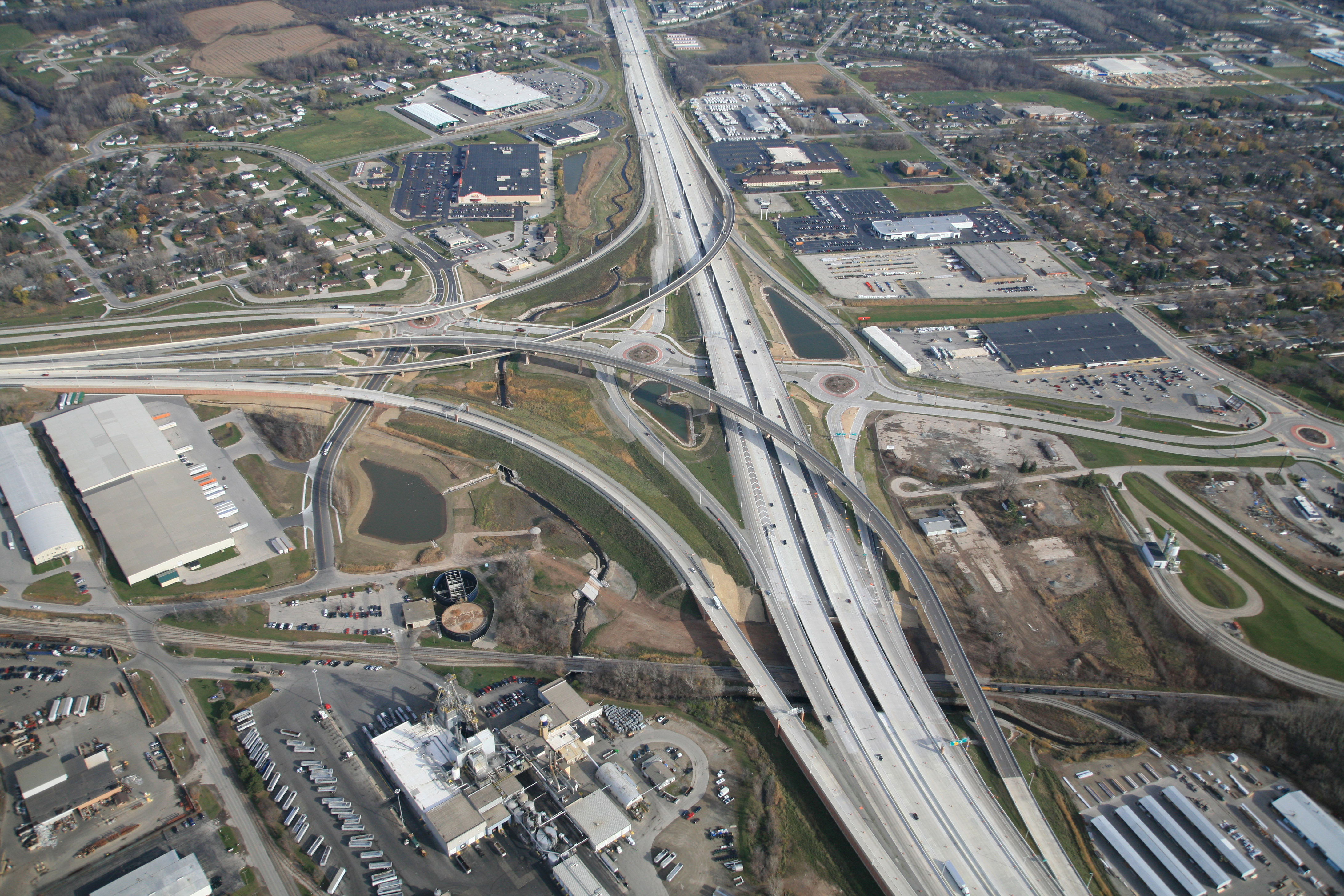 The reconstruction of a major interstate highway by sheer nature of its duration and impacts challenged the design team to look closely and specifically at each individual interchange. Carefully combining unique community identity features and themes with an overall corridor design delivered a project that is cohesive and yet reflective of each individual communities it accesses.
