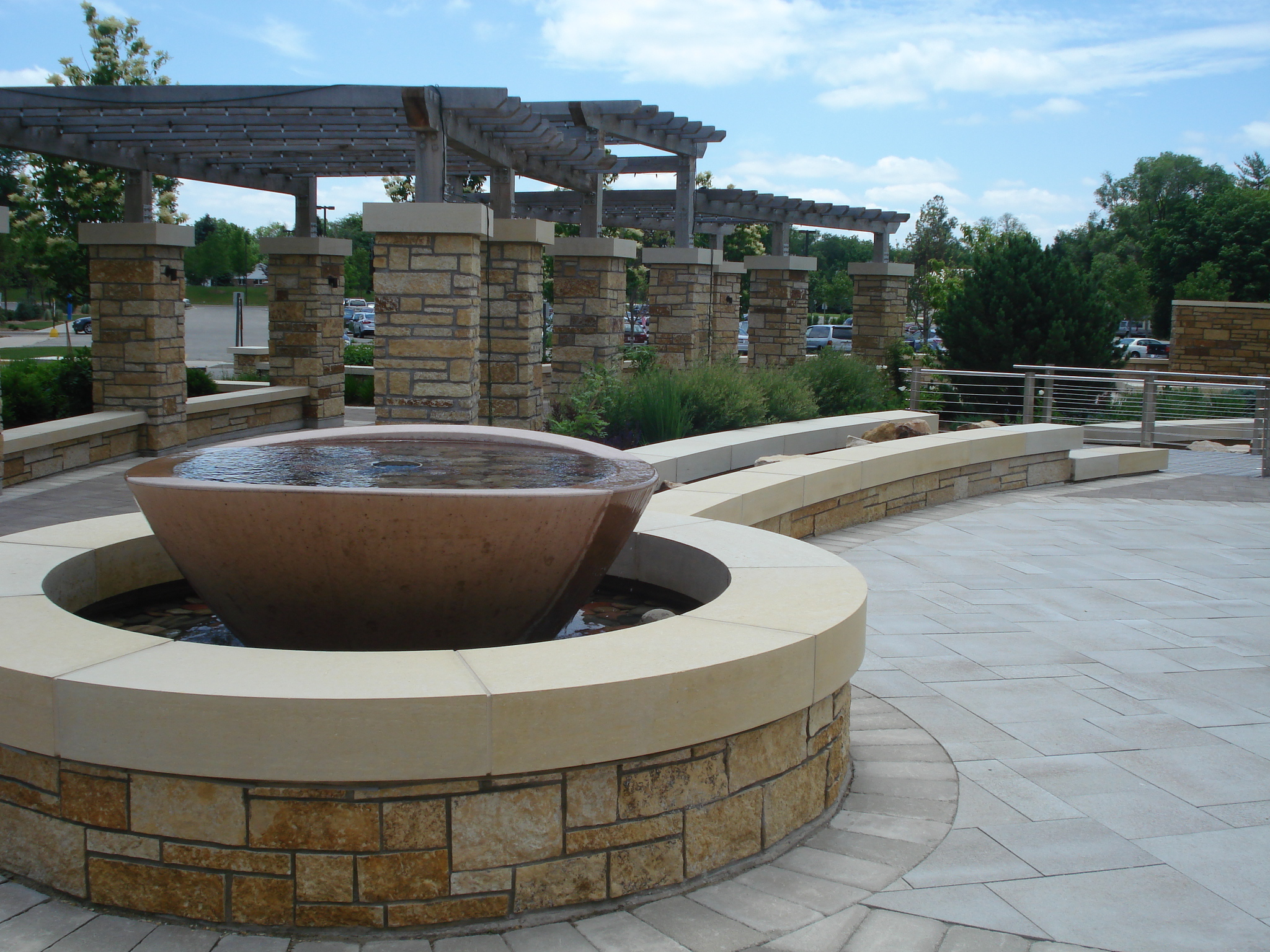 The enhanced entry experience to this important regional medical facility became a contemplative garden space and the design team took cues from the forms and materials of the building's architecture, translating those themes into water features, custom arbors and tactile pavements.