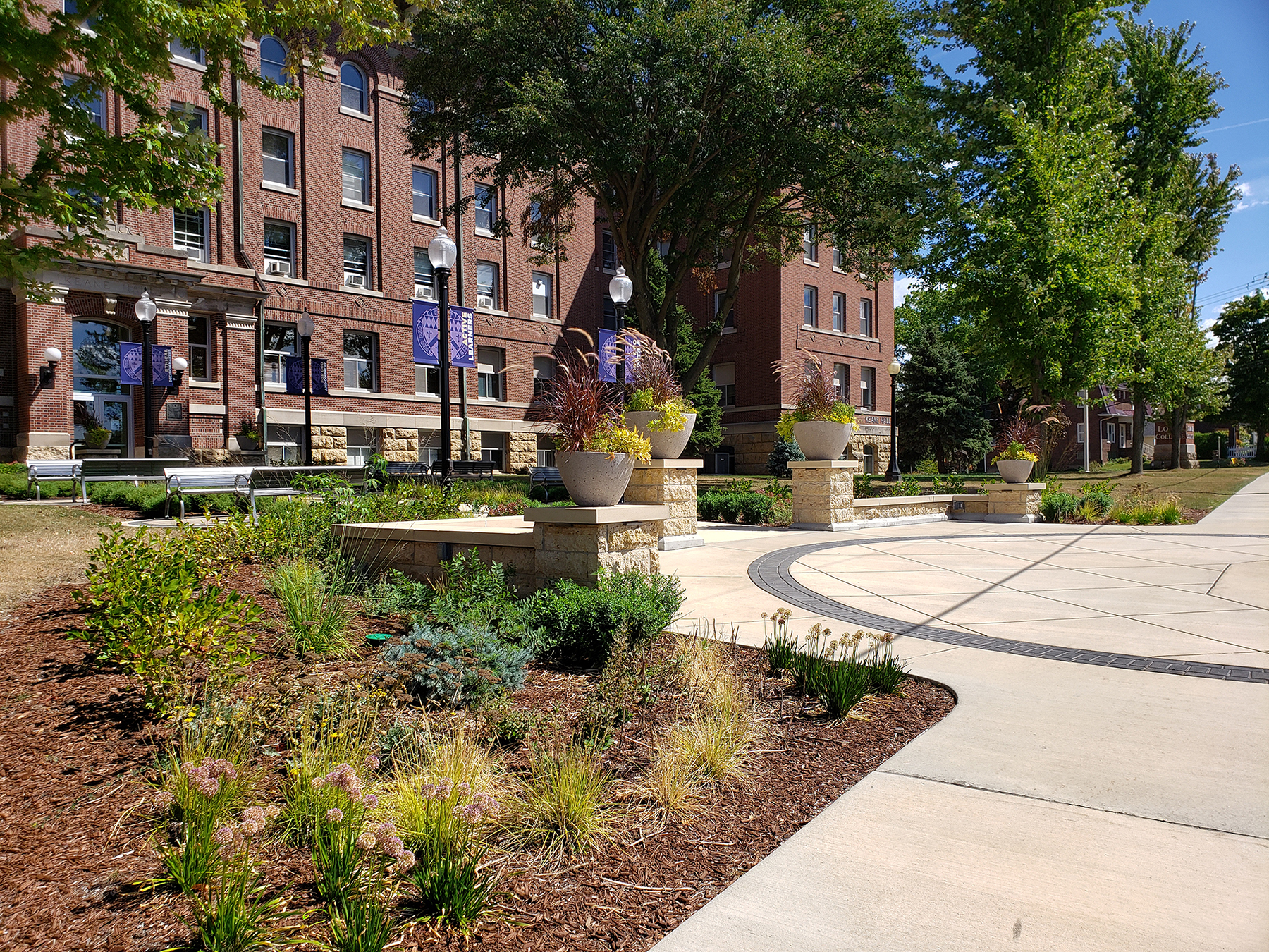 Keane Hall, built in 1913 and an icon of the Loras College campus, embodies a true reflection of the campus – its history and it's special place atop the bluffs of Dubuque – and an exterior courtyard and patio renovation and expansion project now reflects the building's significance and complements the historic architecture and campus identity.