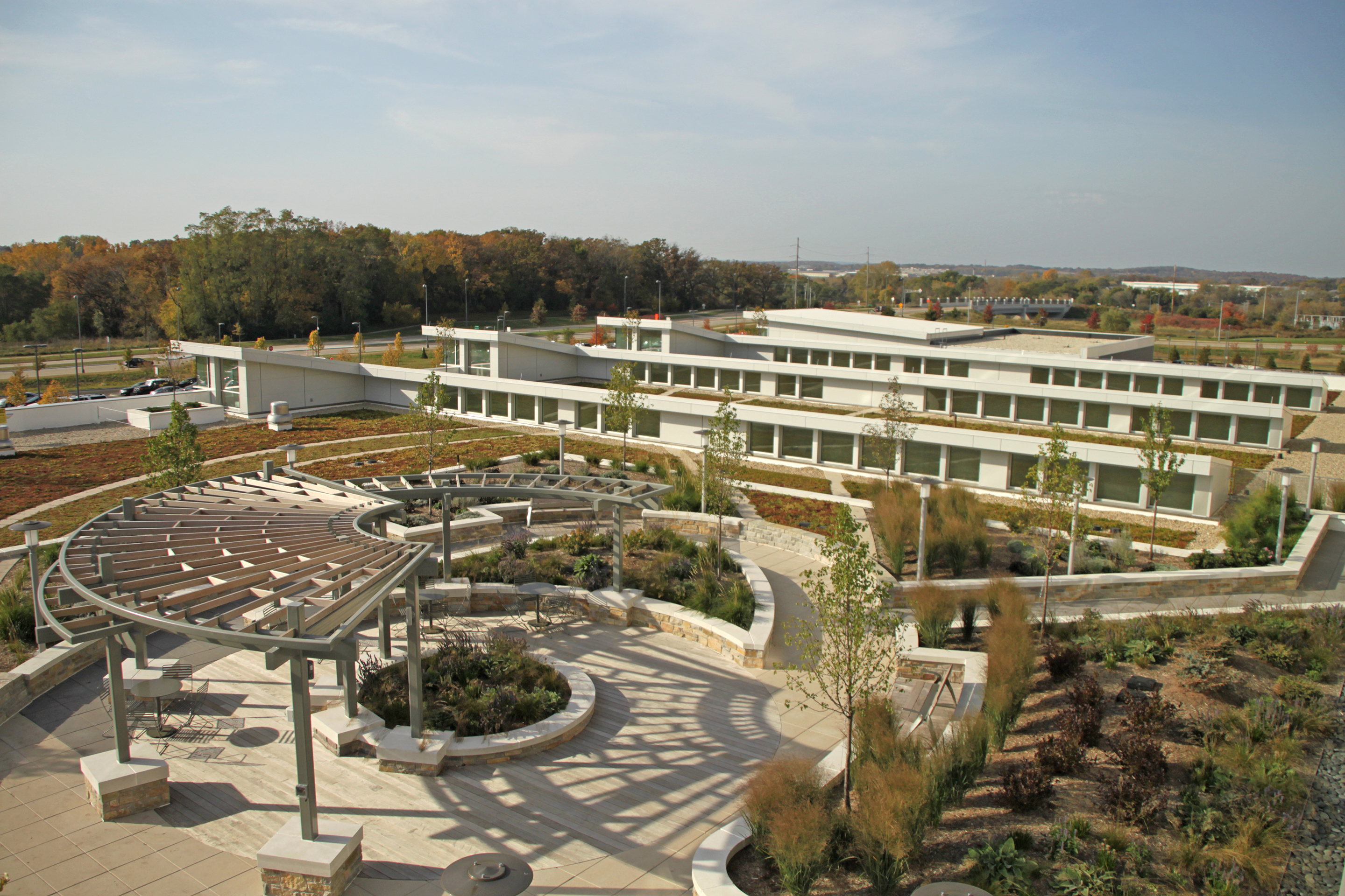 The roofs were designed to serve as an extension of the site; an intensive green roof adjacent to the hospital's cafeteria provides a looped path, seating, a shade structure and lush plantings.