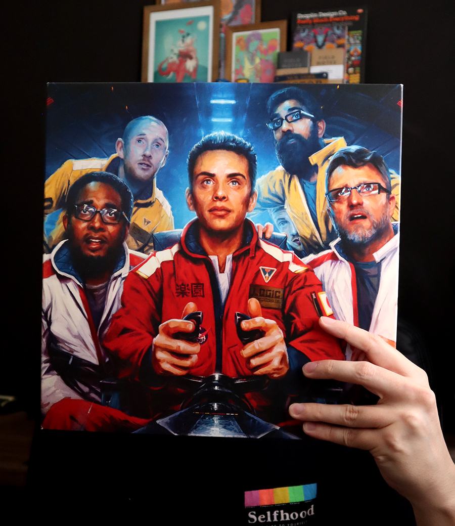 Me holding Logic's The incredible true story on vinyl