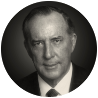 A portrait of Derek Prince in black and white
