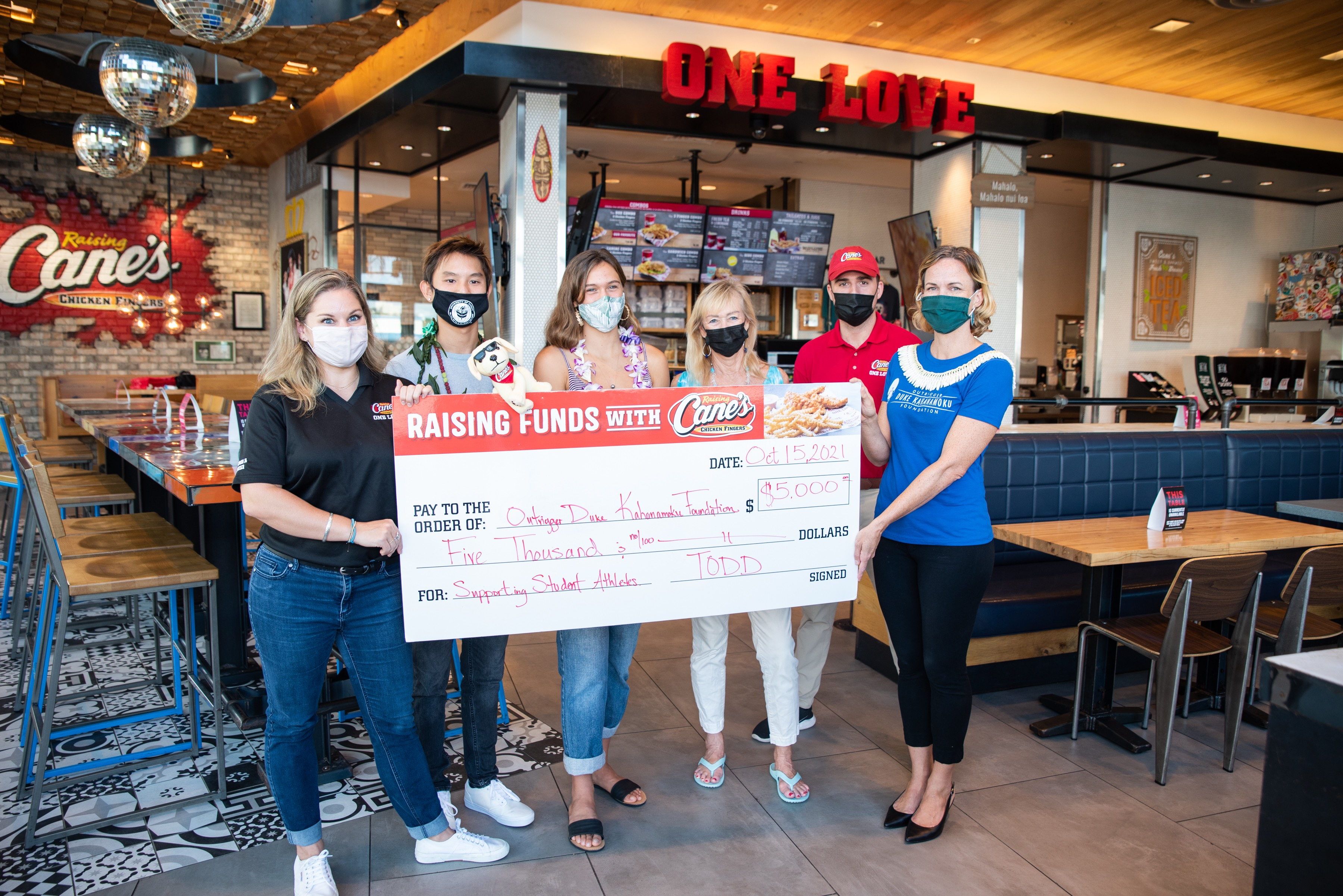 Gift from Raising Cane's helps promote opening of ODKF Scholarships and Grants Applications