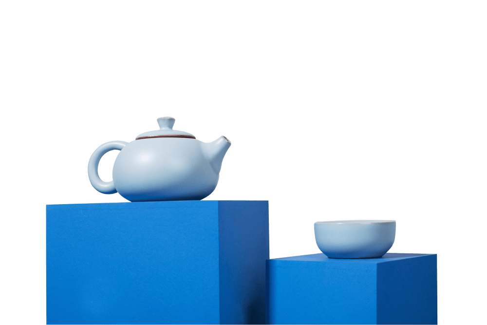 handmade teapot and cups for loose-leaf tea