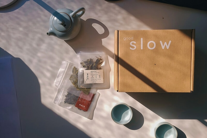 a set of Chinese teaware on table with a goodSlow Discover Box