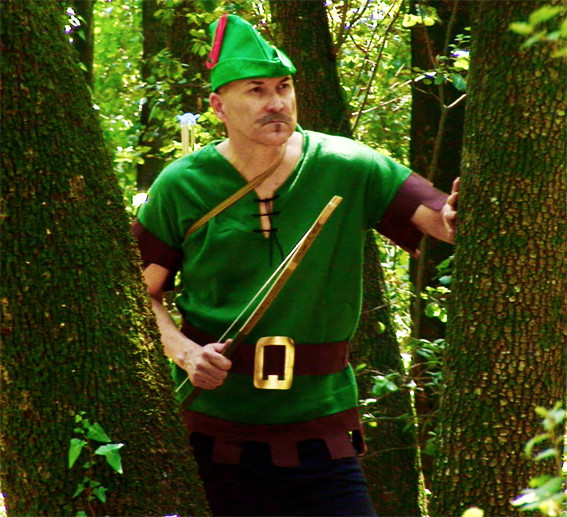 A man dressed as robinhood in a forest