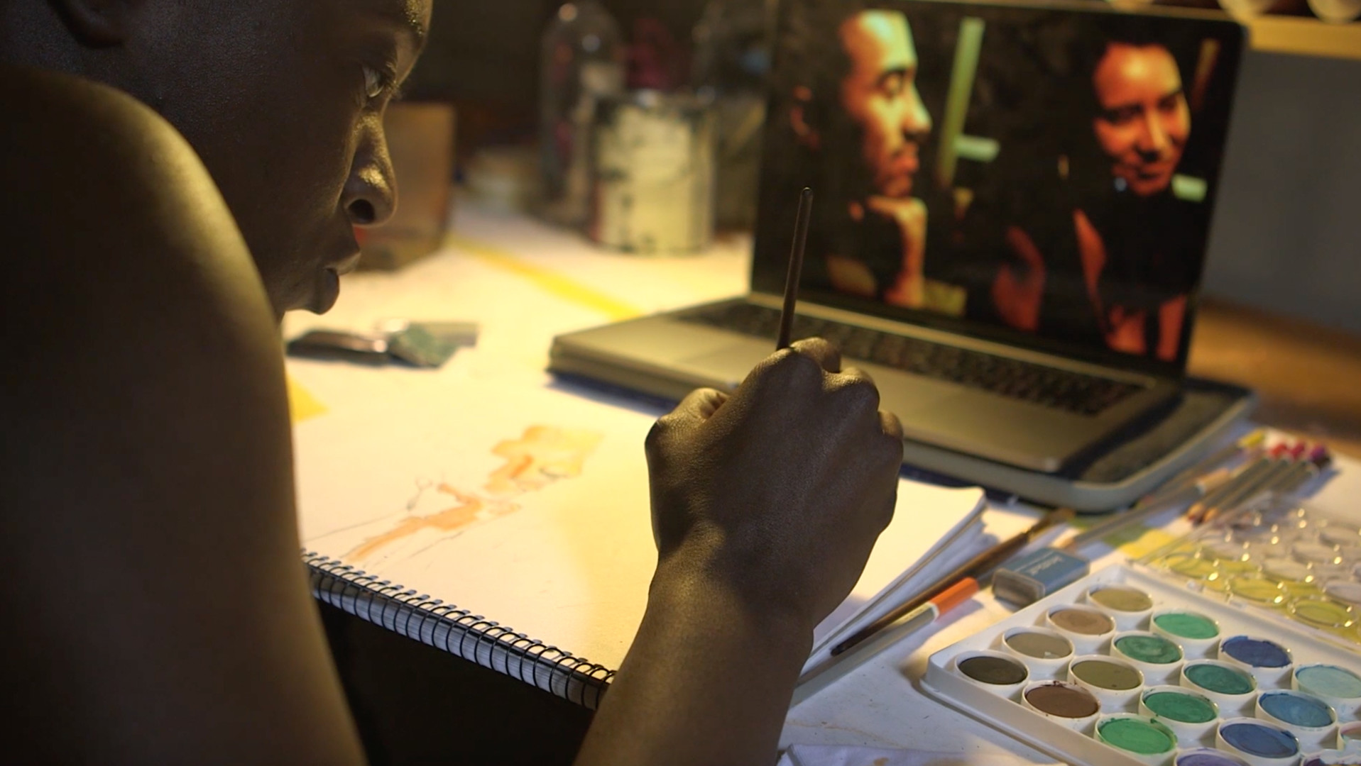 A person paints from a computer image