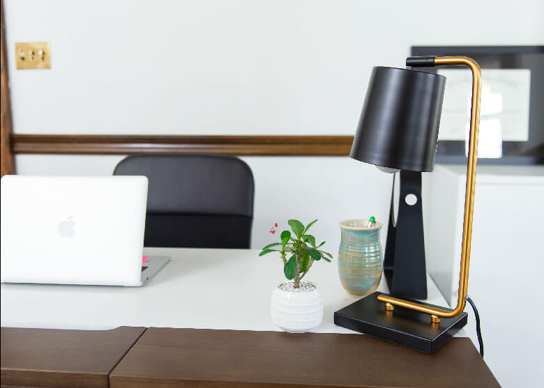 A picture of a desk and lamp at Mend Osteopathy.