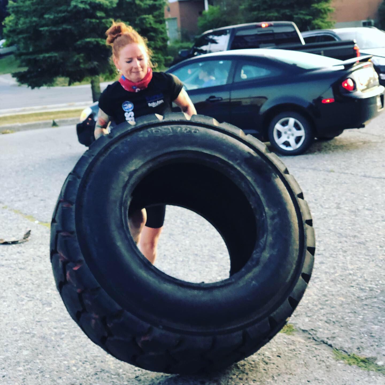 Woman lifting a tire