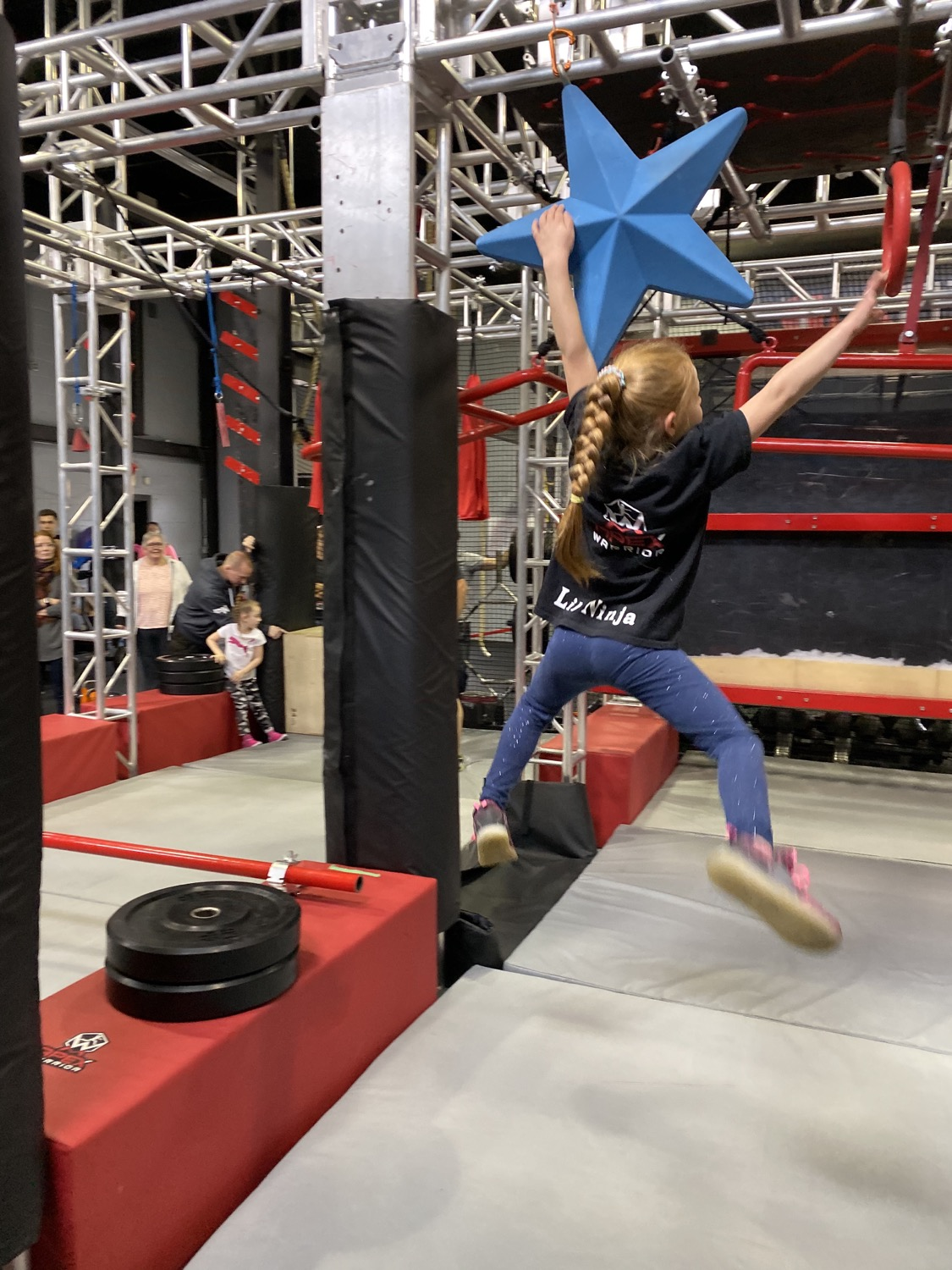 Kid swinging from star to ring