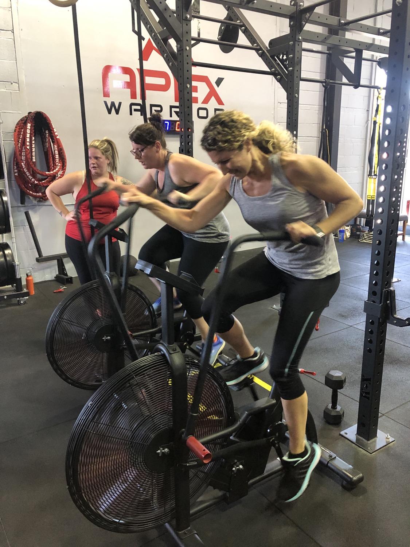 Women riding air bikes