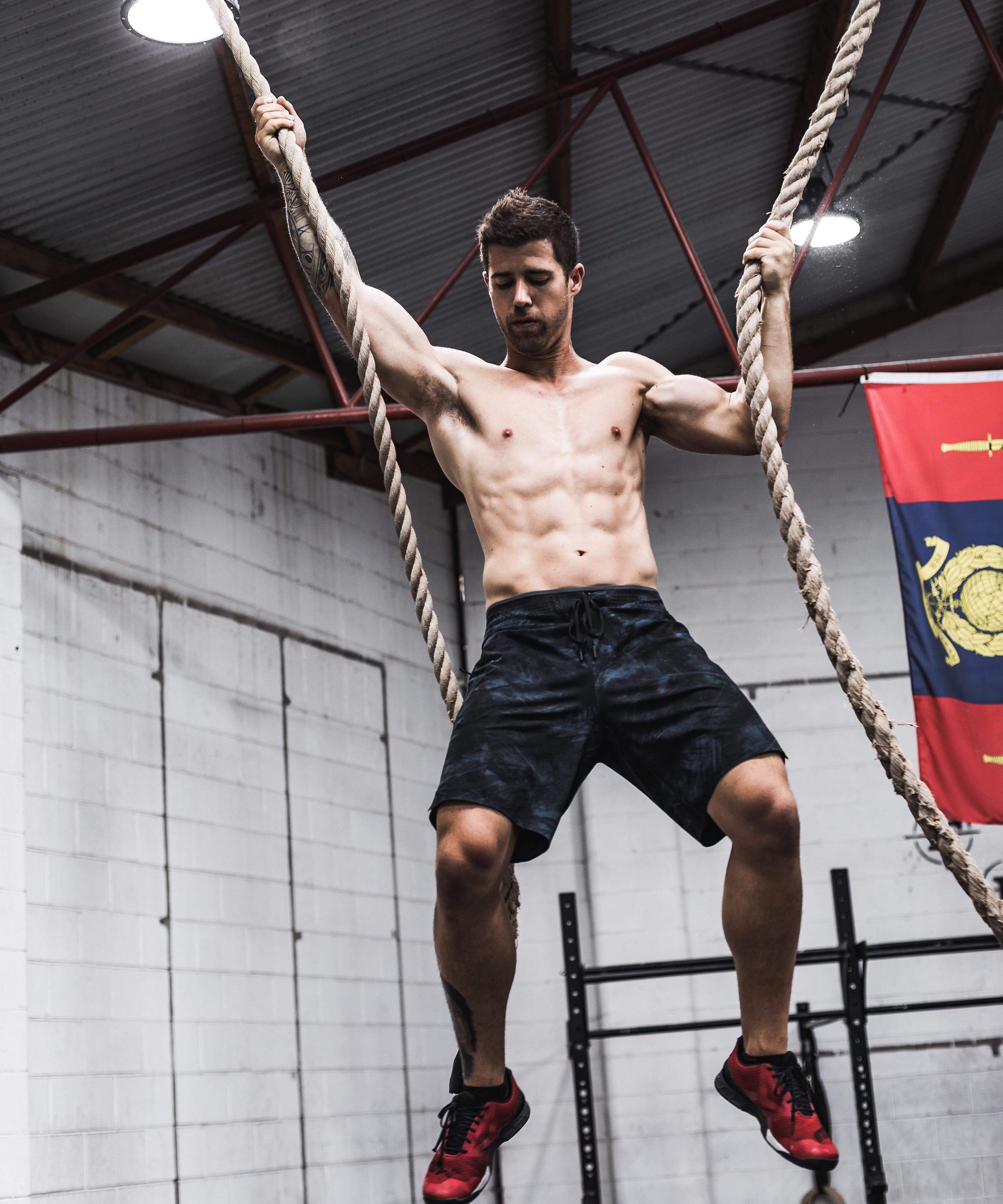Dennis hanging from ropes