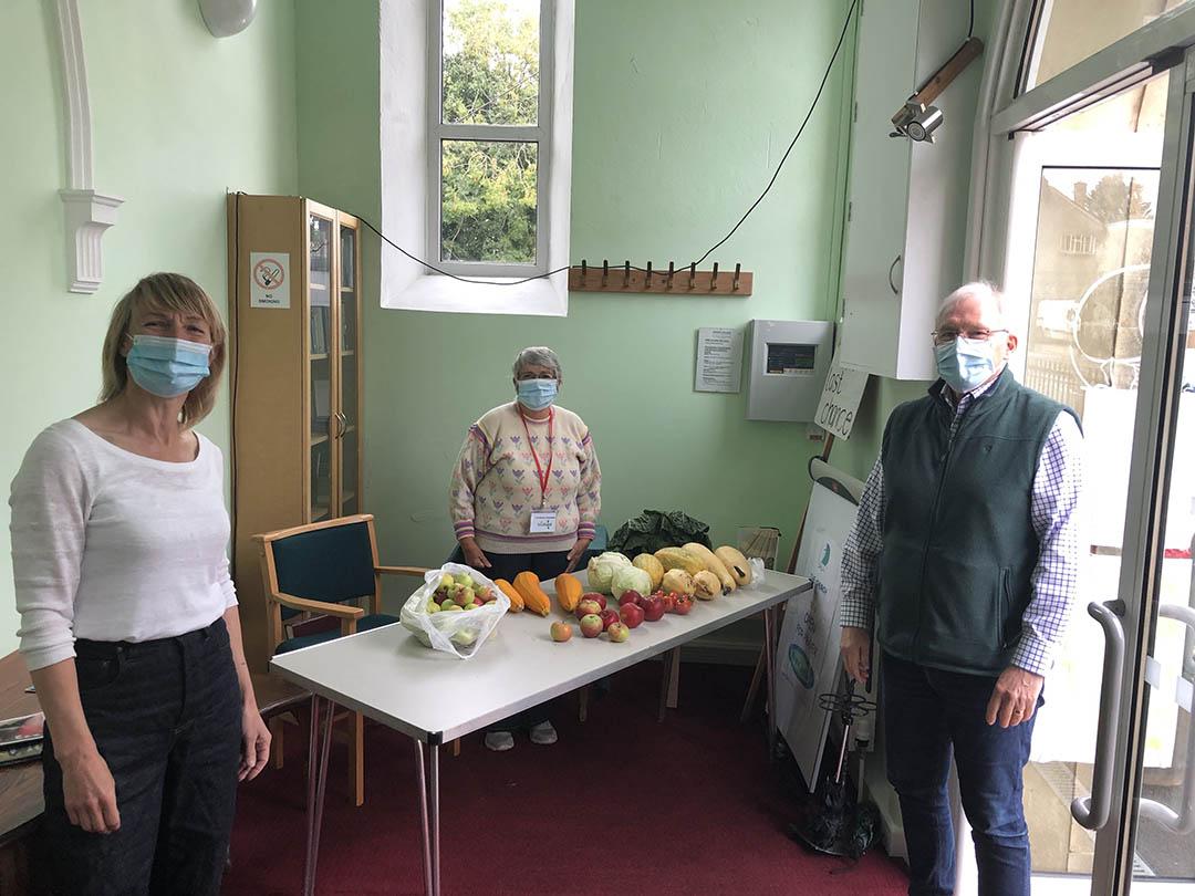 Sharing table of fresh vegetables at Peasedown St John