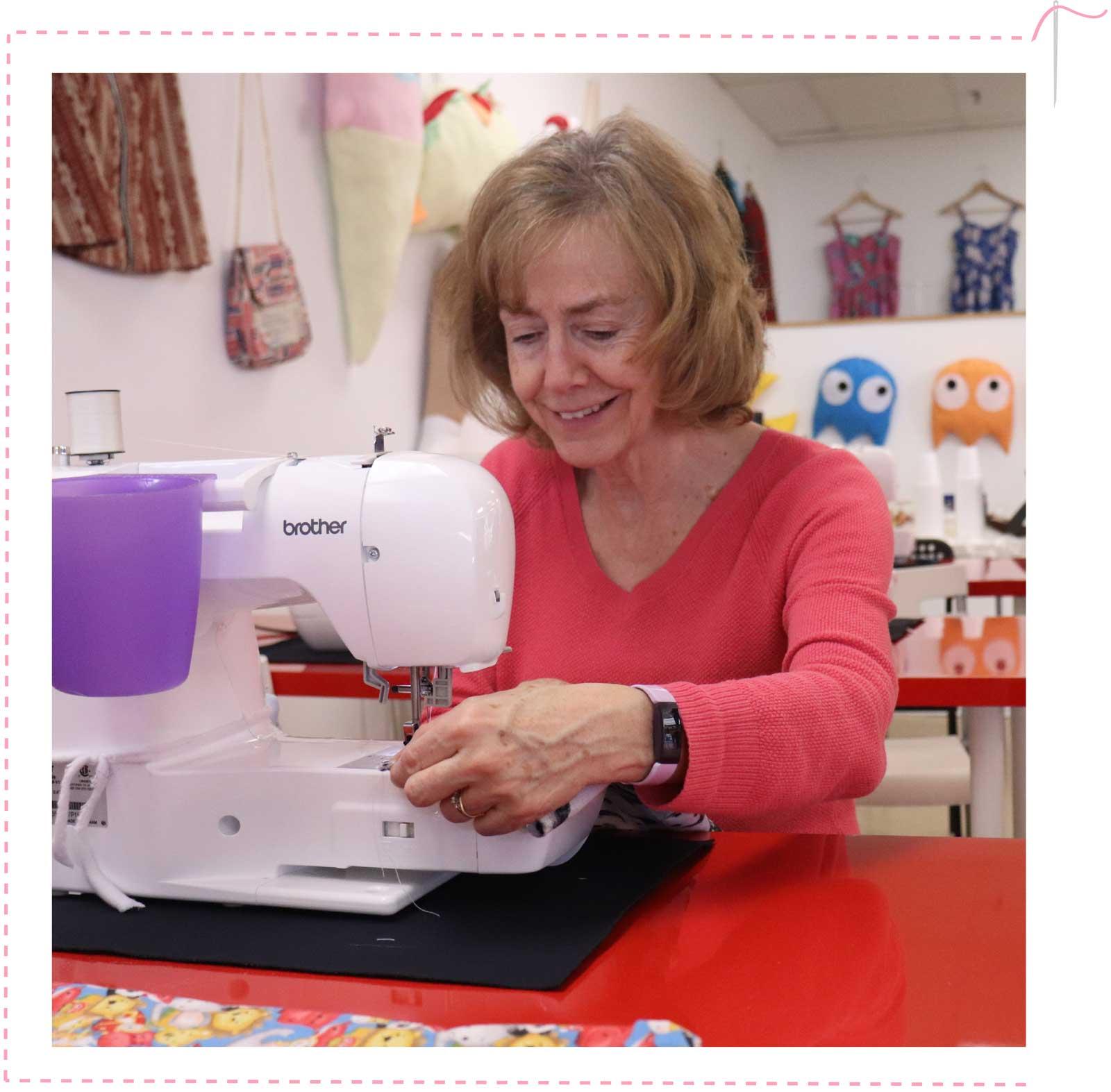 Volunteer sewing Comfy Cases.
