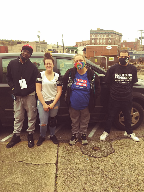 River Valley Organizing Members standing in front of a car in East Liverpool, Ohio
