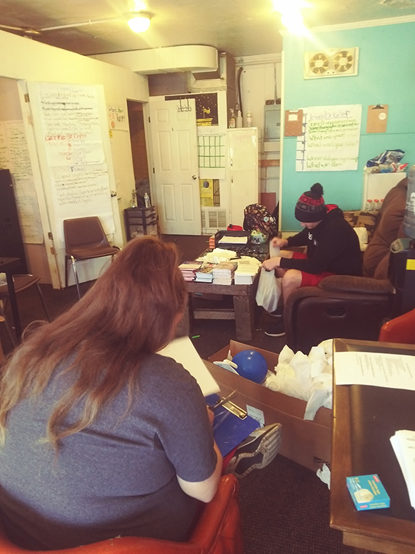 Members of River Valley Organizing having a meeting inside their East Liverpool, Ohio Office.