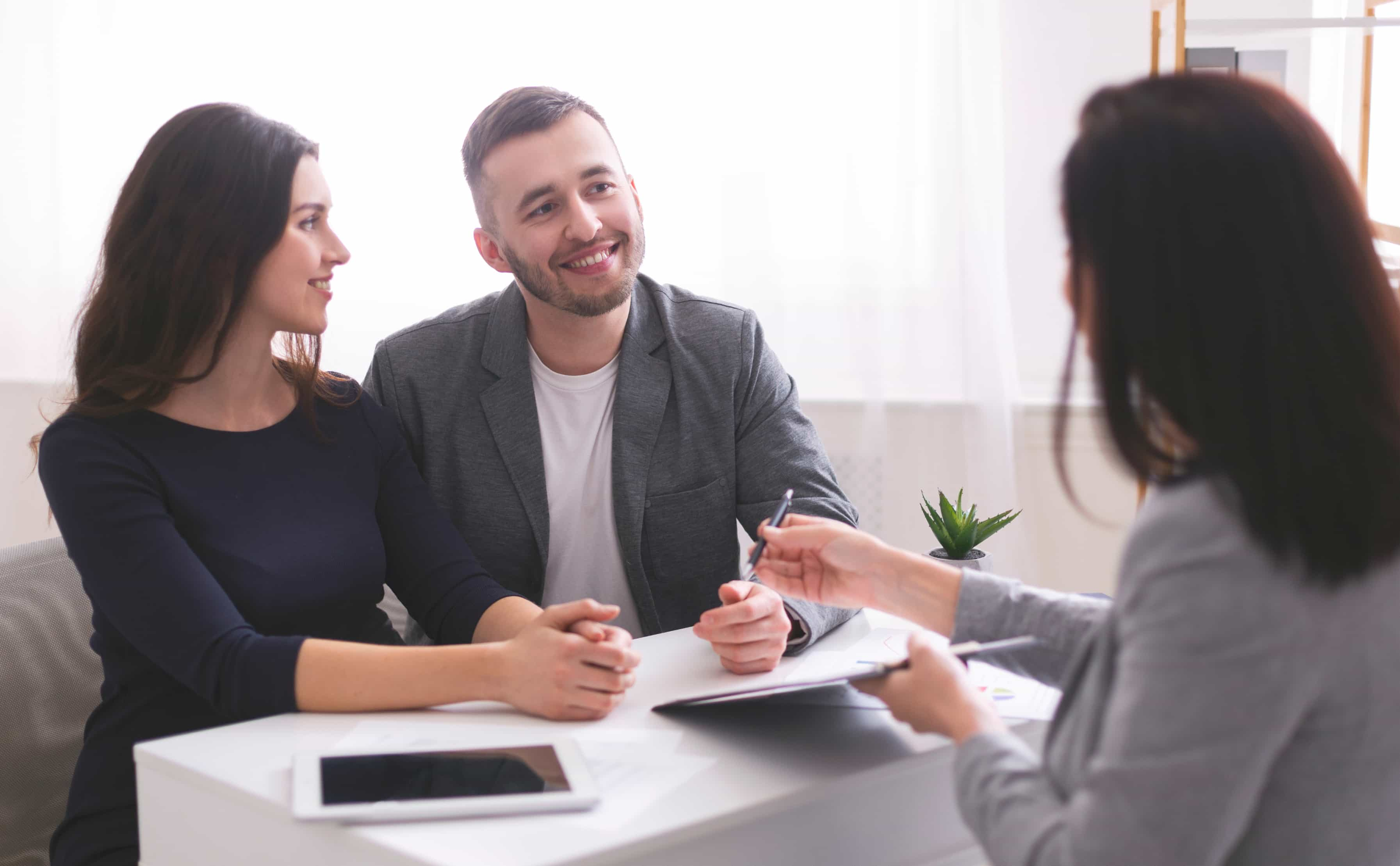 Couple reviewing documents with a realtor
