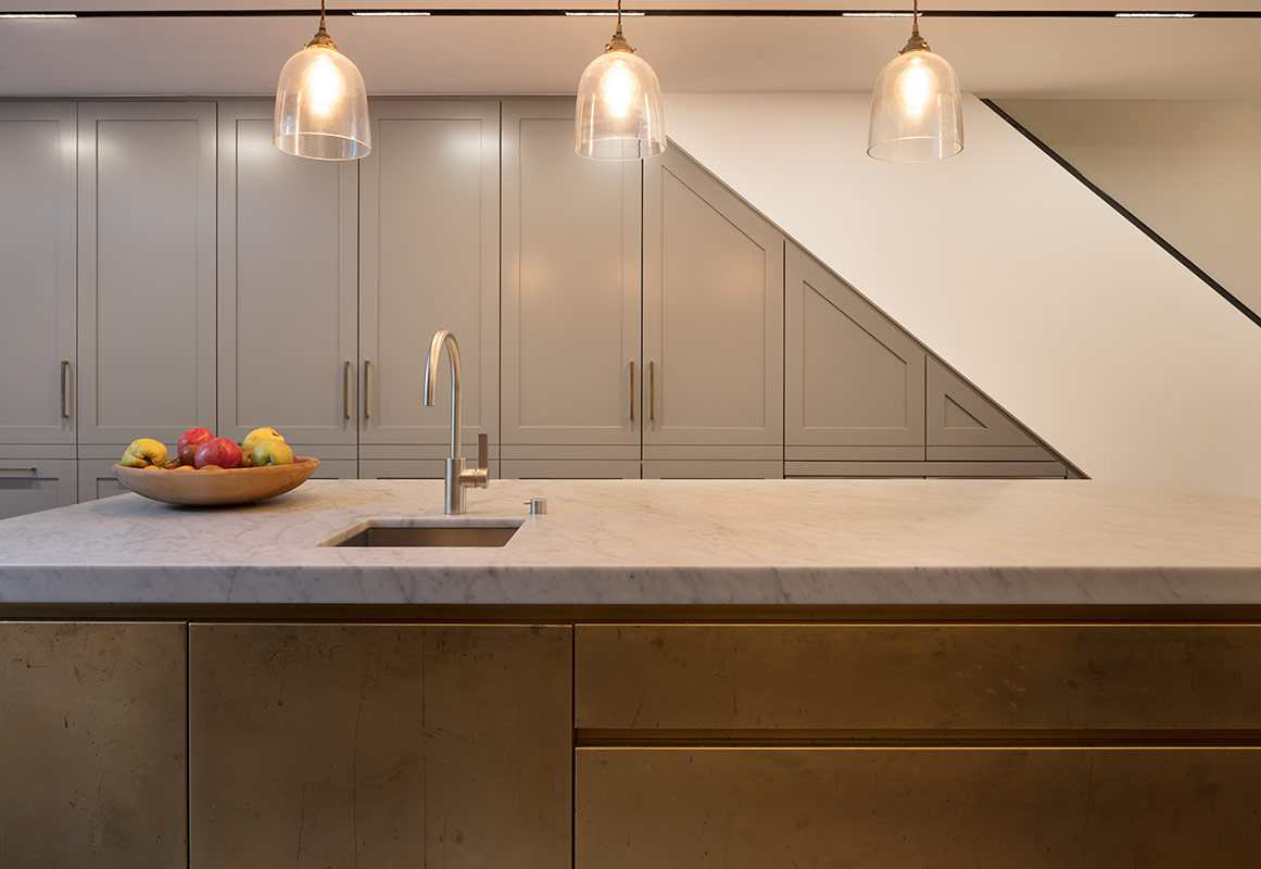 brass kitchen and stone tops