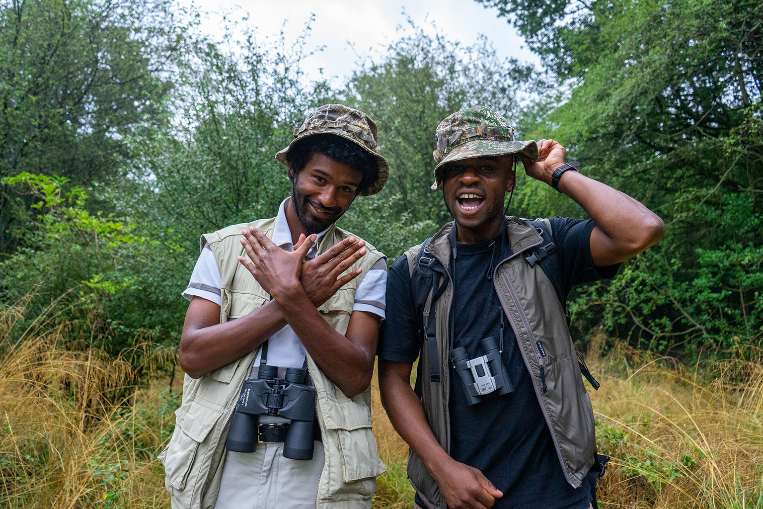 A photo in a woodland setting of Flock Together founders – Ollie Olanipekun and Nadeem Perera.