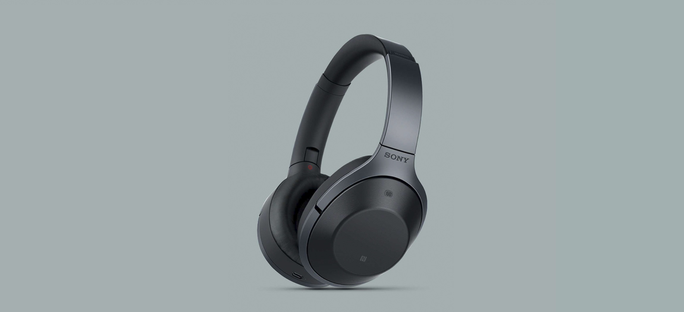 A pair of headphones floats in the air
