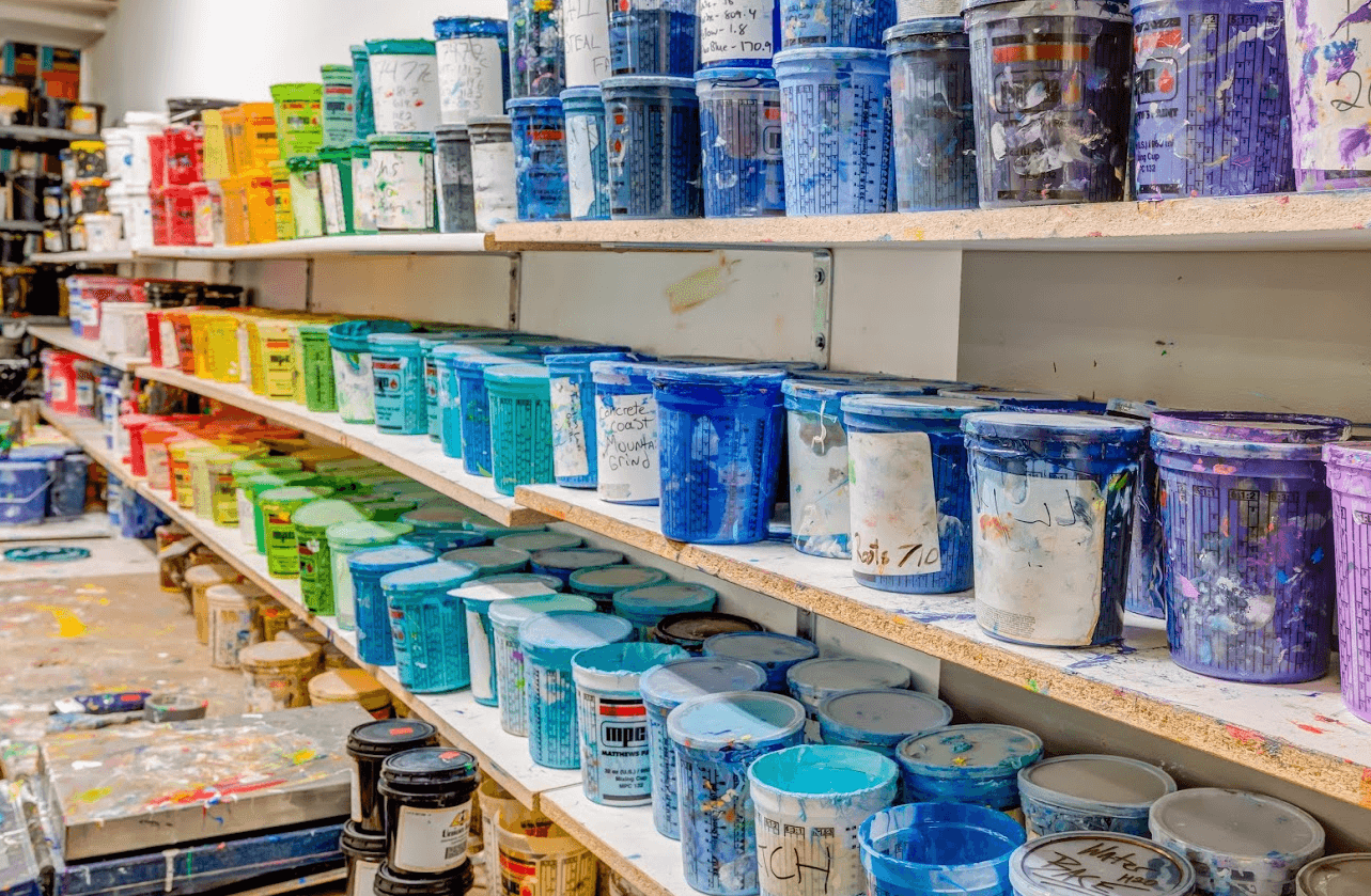 Colorful screen printing inks on wall at Denver based Superior Ink