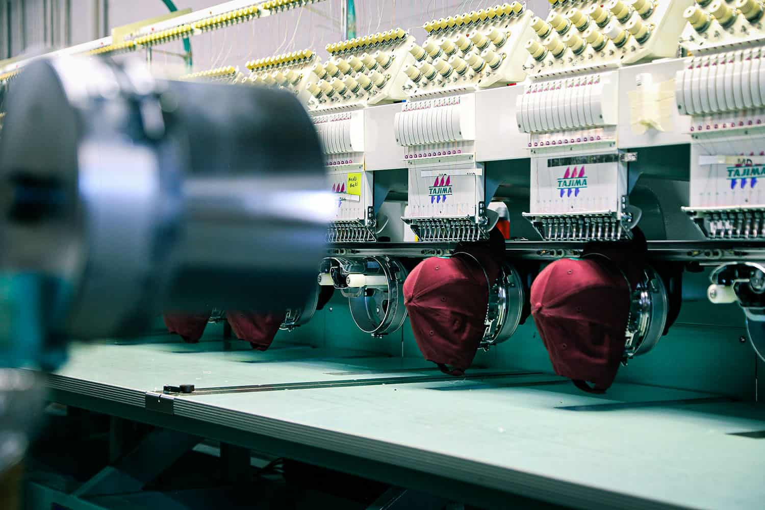 Large scale embroidery machines setup for contract embroidery