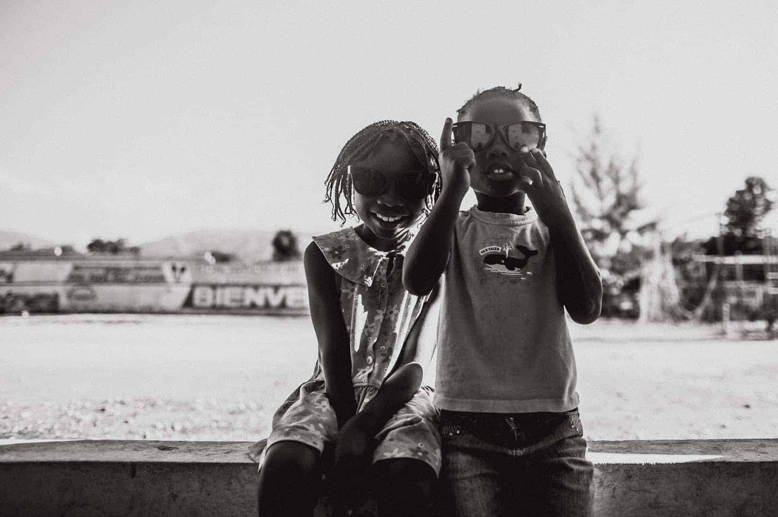 Two kids smiling in Haiti at Allmade Apparel