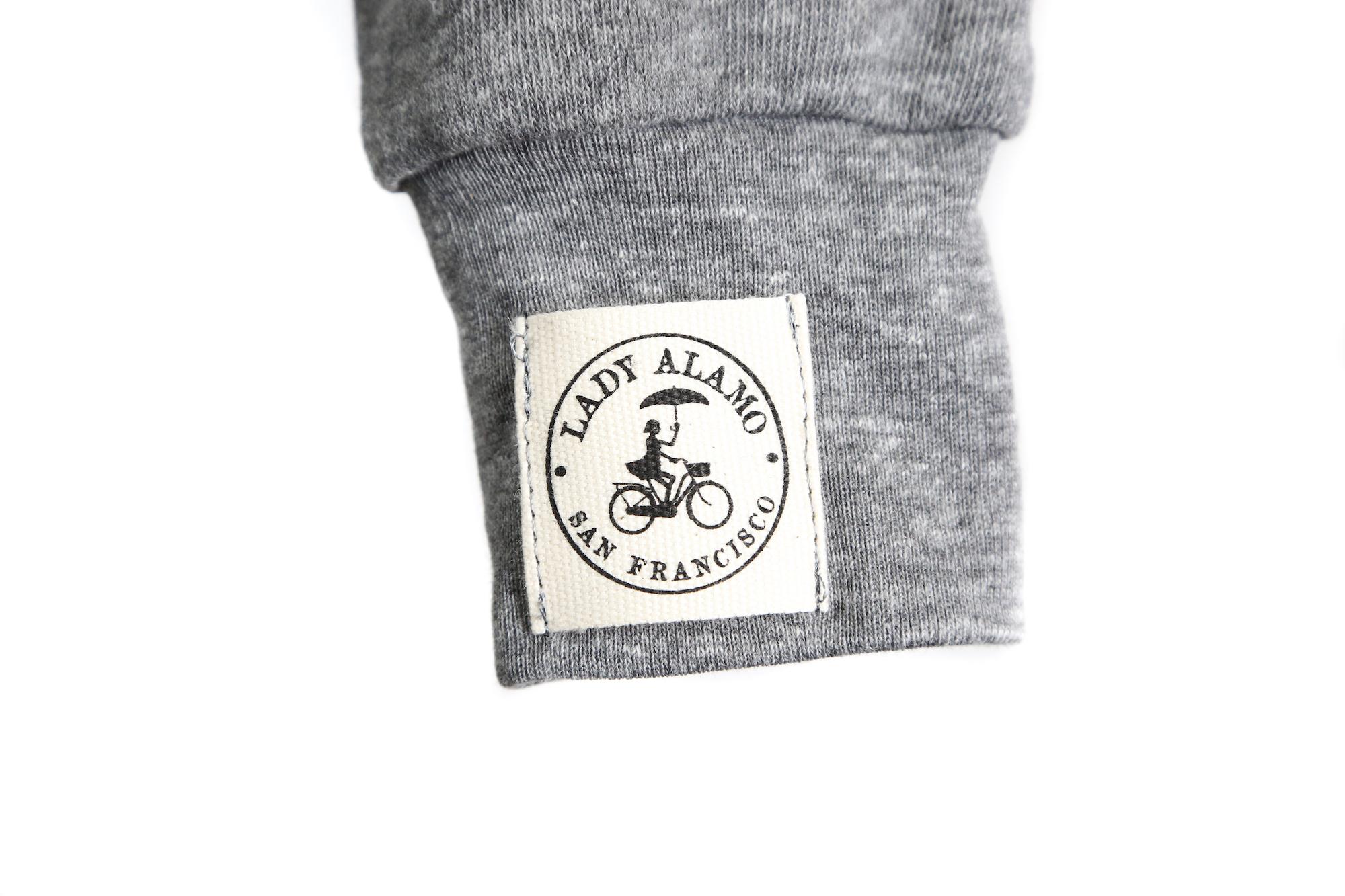 Custom woven label on sweatshirt sleeve