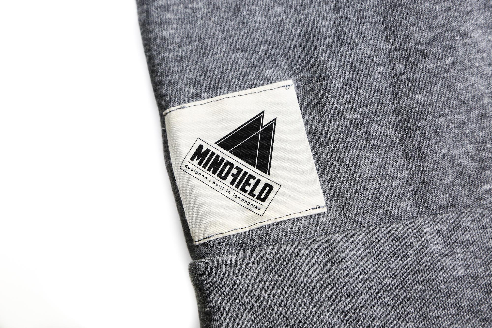 Mindfield woven tag sewn onto shirt