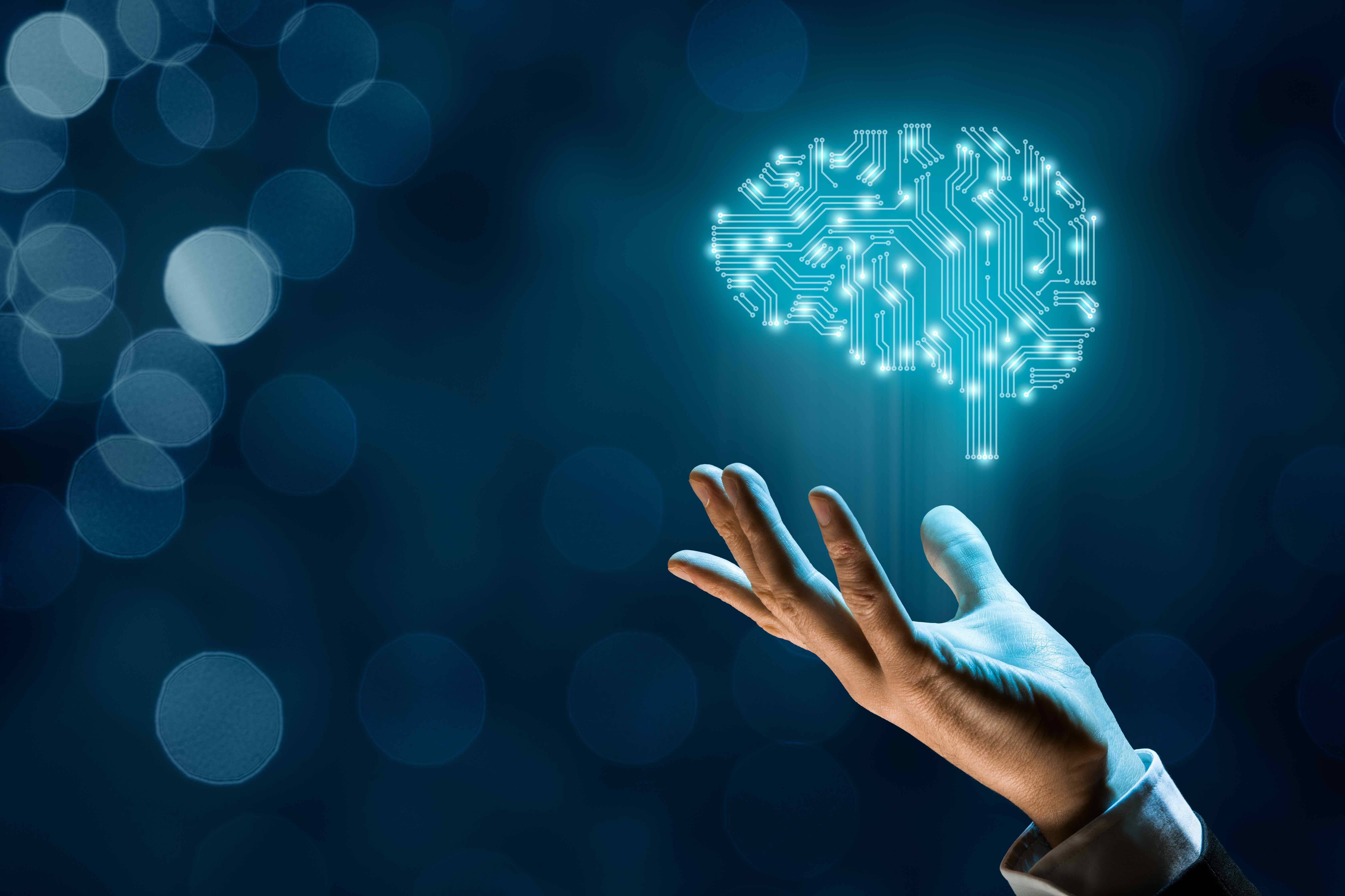 Hand holding Visualization of Electronic Brain