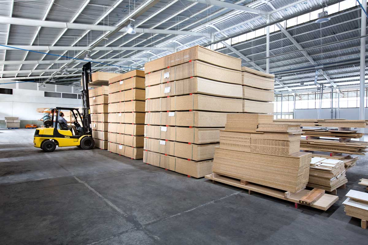 Stacks of wood panels in factory hall, imported from Europe for it's unmatched quality.