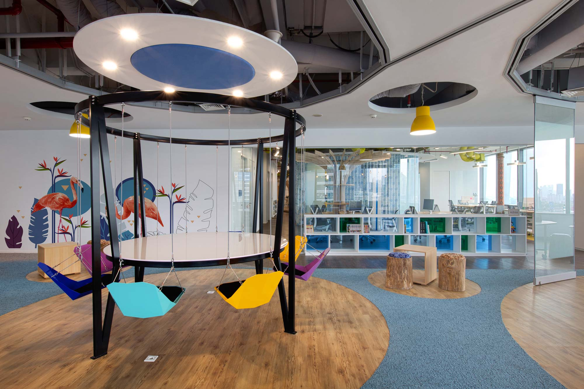 Fun and colorful informal meeting area with swingchairs in DANA's new office in Jakarta. Interior Design + Build by AVIP