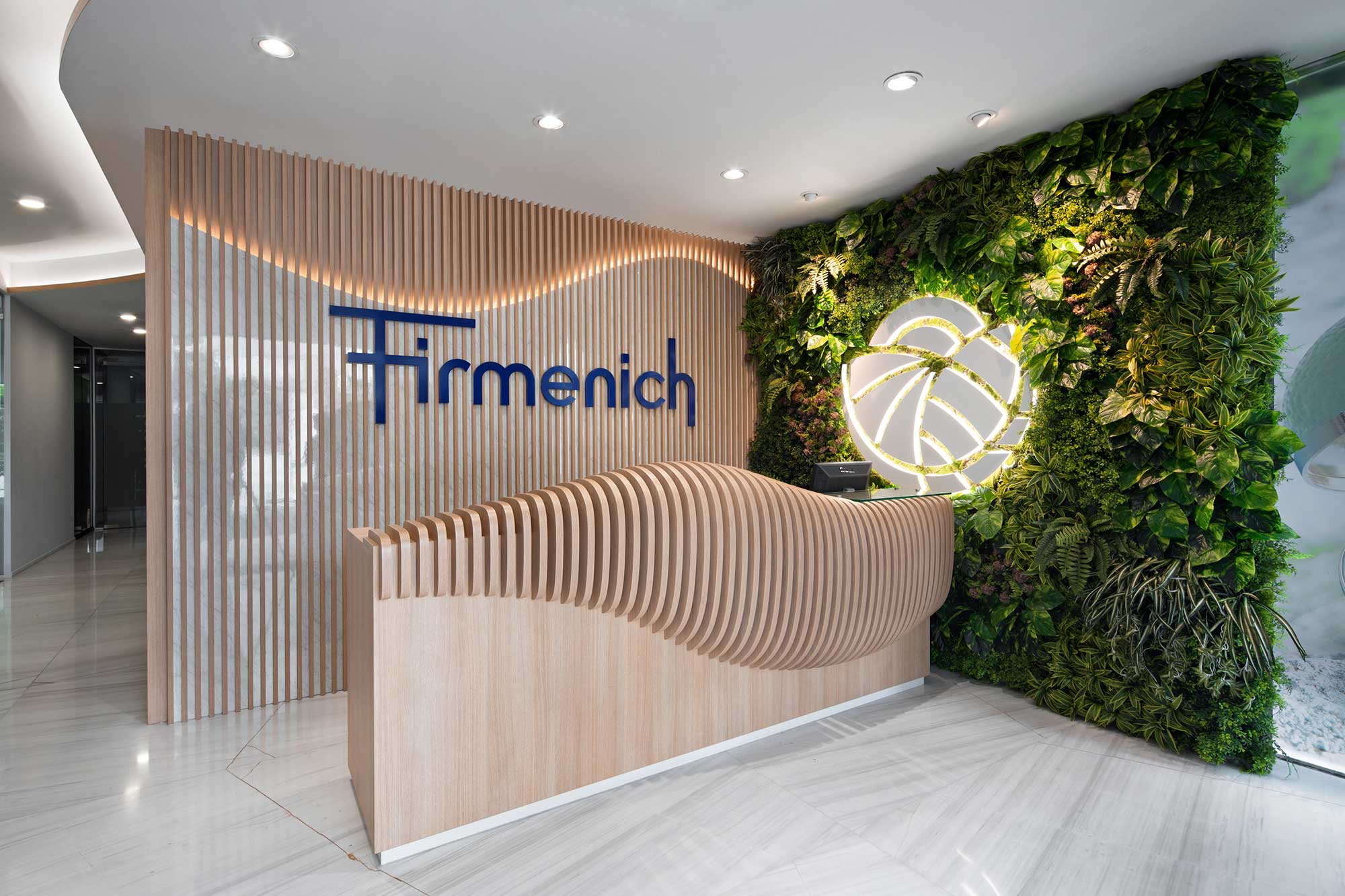 Firmenich's new reception, using natural elements to reflect their core value. Interior Design + build by AVIP.