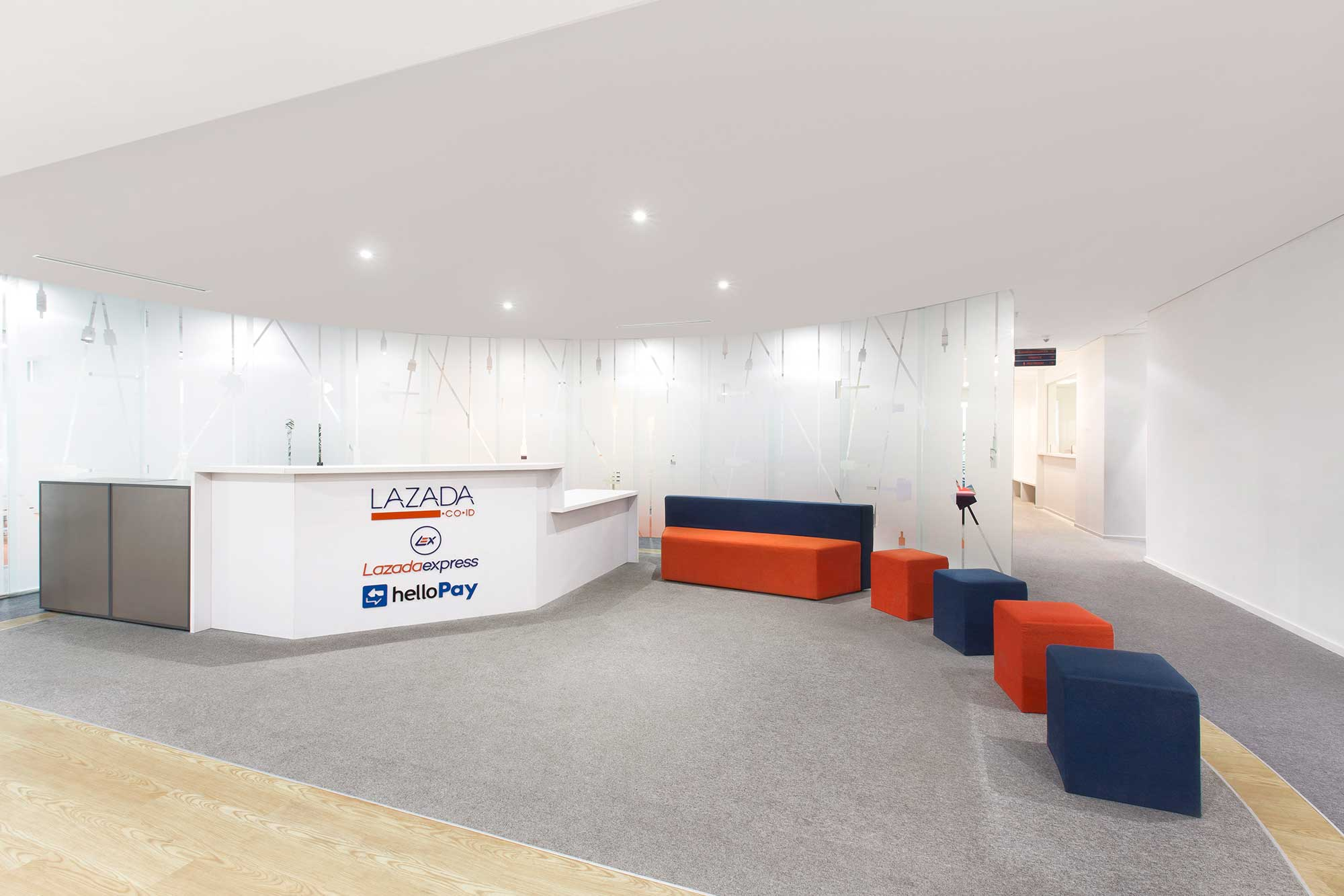 Bright and open reception area of Lazada's office. Interior Design + Build by AVIP.