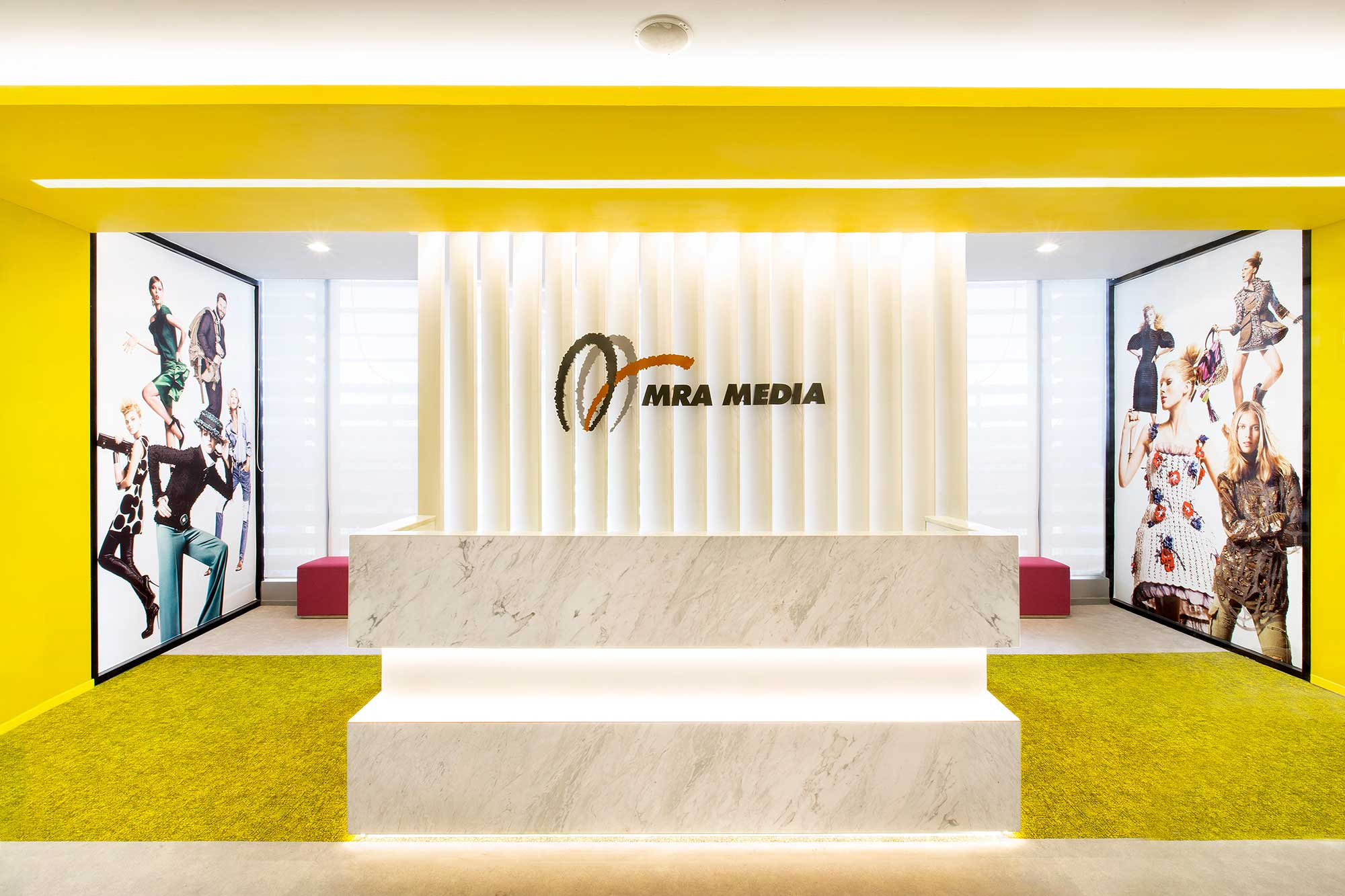 The bright and stylish reception area for MRA's new office. Interior Design + Build by AVIP.