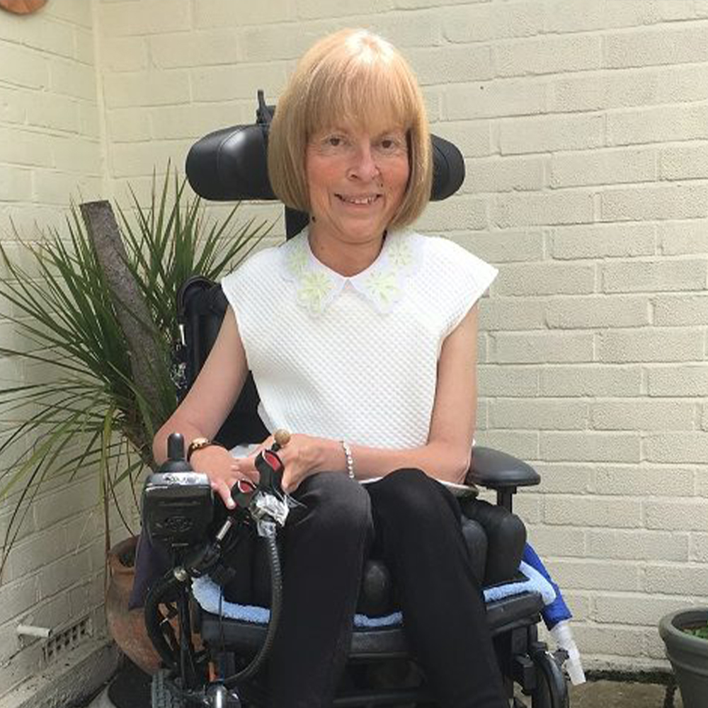 Jane Campbell sitting in wheelchair smiling