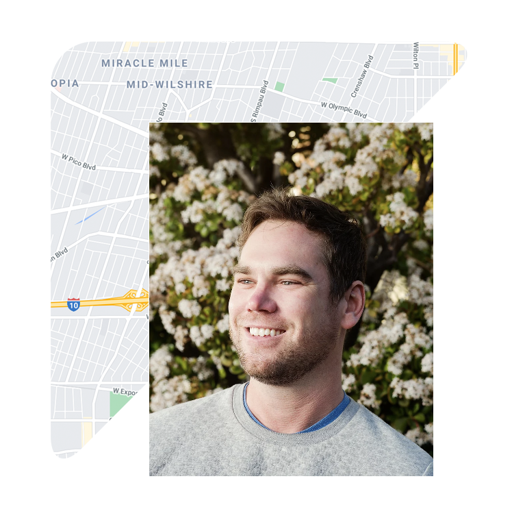 Smiling customer with map of los angeles behind him.